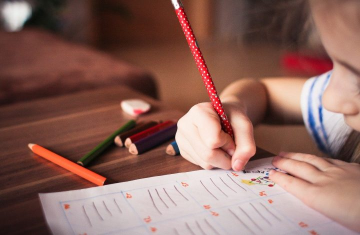 child writing | beating summer learning loss