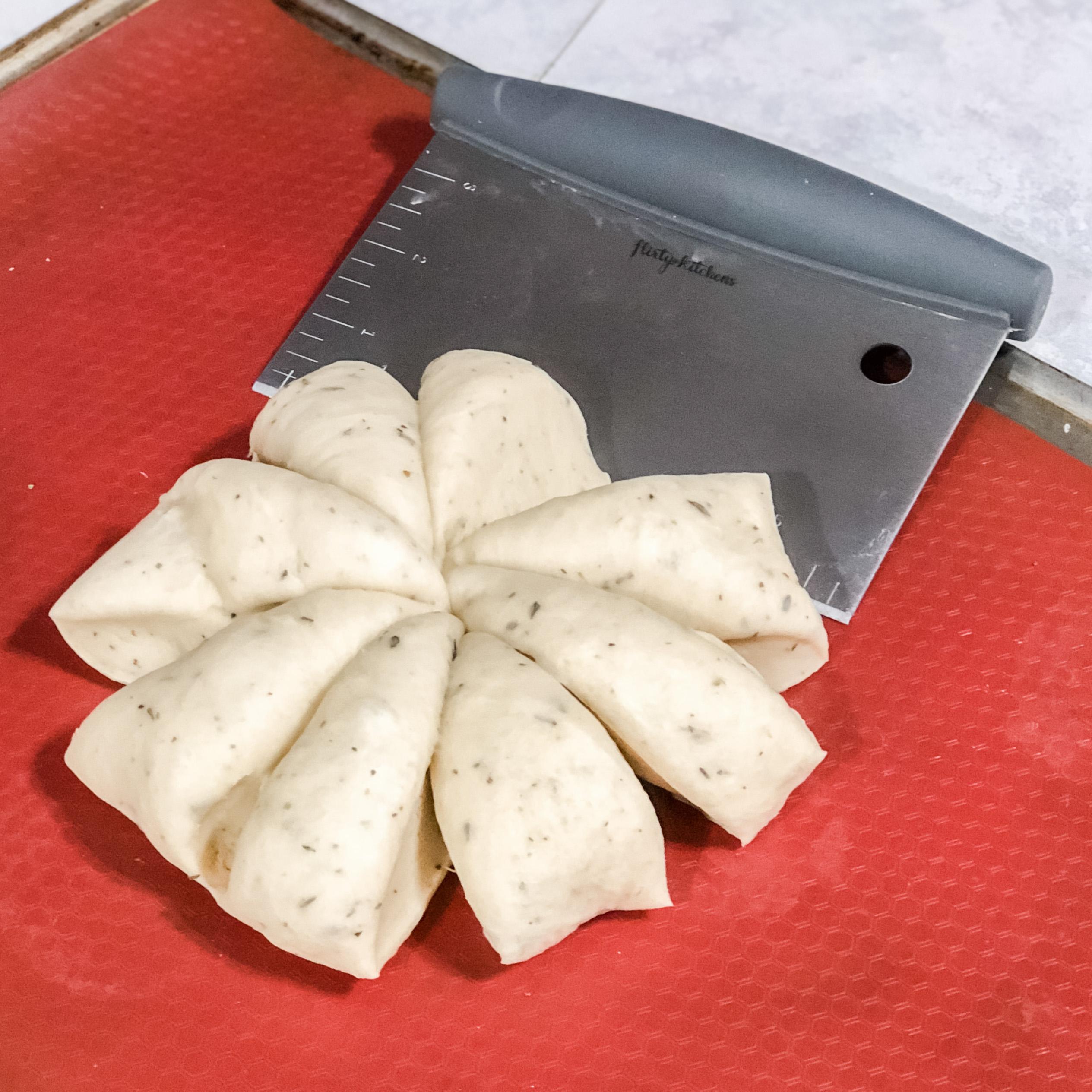 Dividing the dough with a dough cutter
